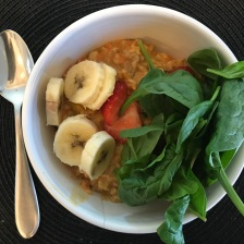 Carrot Cake Oatmeal, Rolled Oats, Raisins, Walnuts, Cinnamon , Pumpkin Spice, Fruit, a hand full of Raw Spinach